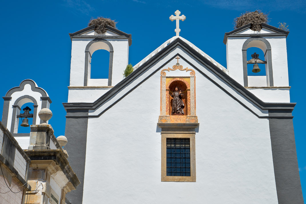 Stork nests atop church