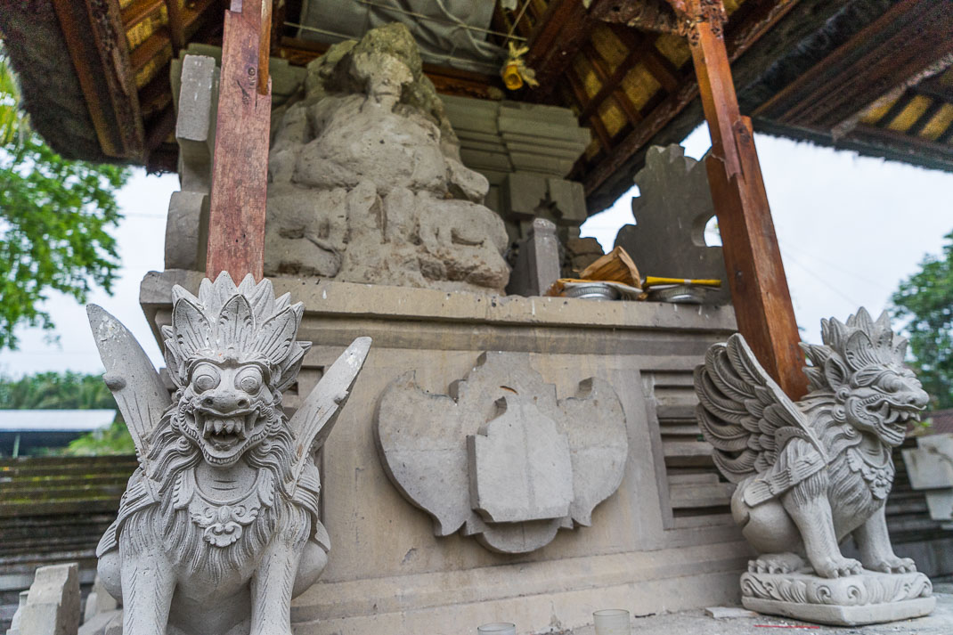 Balinese Temples Crumbling Statue