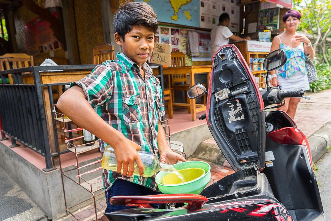 Ubud Boy Pouring Petrol