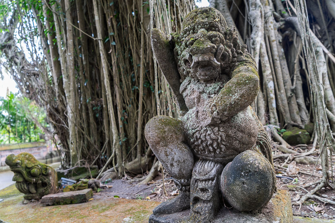 Ubud Temple Vines Statue