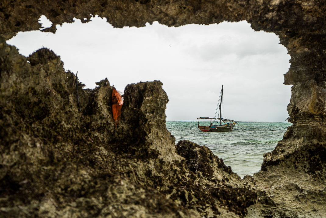 Zanzibar Matemwe dhow through rocks
