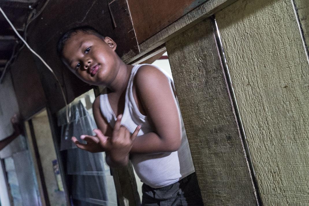 Hidden Jakarta Alleyway Kid Signs