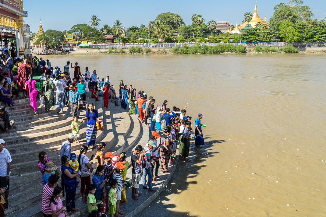 Yangon Temples Yele Offerings Toss